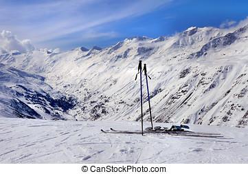 Skis and ski poles in Alps
