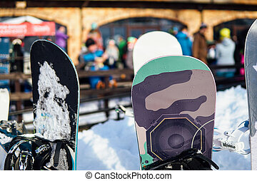 skis and Snowboards on the background of the ski resort vacation