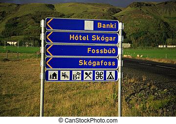 Skogafoss signpost - Signpost to Skogafoss waterfall, the...