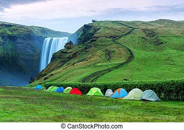 Skogafoss - Camping tents near the famous Skogafoss...