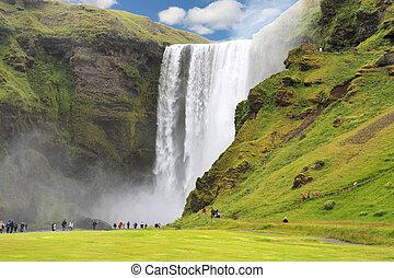 Skogafoss - famous Waterfall near Skogar in Iceland. Beauty...