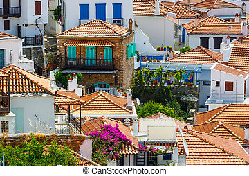 White houses with red roofs in Skopelos town, Greece.