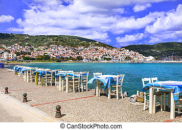 Skopelos island, view of town and restaurant near the sea. Sporades,Greece