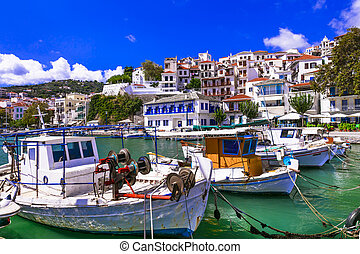 Traditional colorful fishing boats in old port of Skopelos. Sporades islands