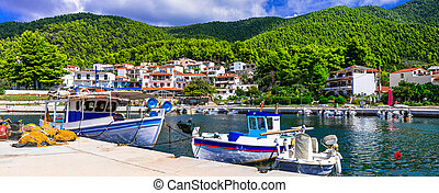 Skopelos island- traditional fishing village Neo Klima with colorful boats. Northen Sporades of Greece