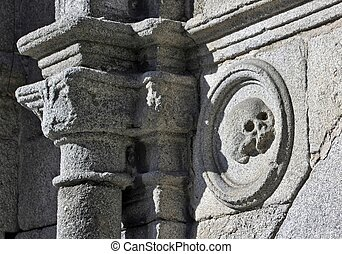 skull carved in stone on a facade