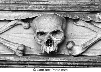 Skull carved in stone - Stone skull carved in tombstone on a...