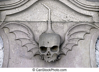 Skull carved in stone - Stone winged skull carved in stone...