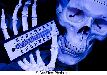 Skull holding a thermometer. A metaphor of the Climate change