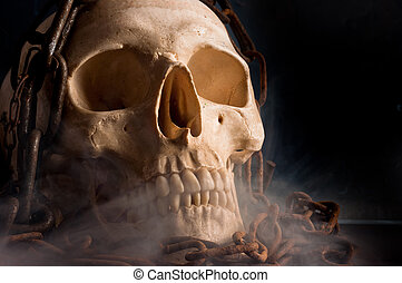 Skull in abstract smoke with chains