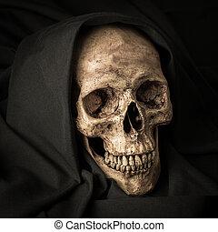 skull in black hood - Human skull in black hood as image of...