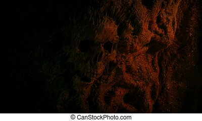 Skull In Cave Wall Lit Up In Fire Light