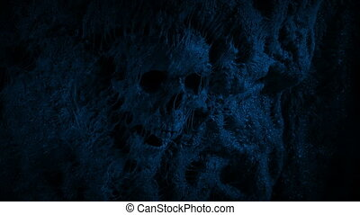 Skull In Slimy Cave Wall At Night - Old human skull lodged ...