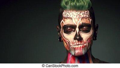 Skull make up of young man. - Halloween face art. Skull make...