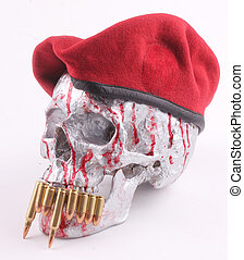 skull - A bloodstained human skull with a red beret and...