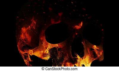 Skull Rotates In Flames Abstract Closeup - Human skull...