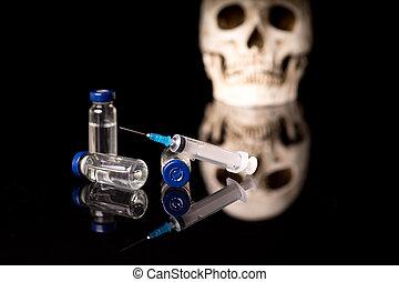 Skull, syringe and medical vials