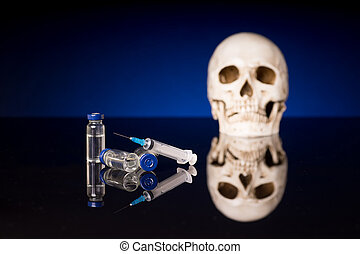 Skull, syringe and medical vials on glossy