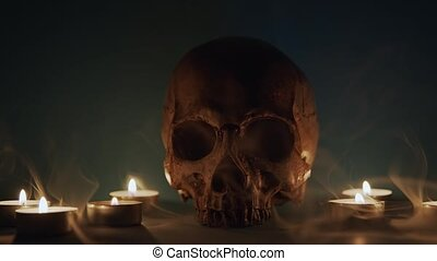 Skull With Smoke And Candles closeup footage - Skull With ...