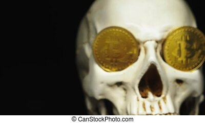 Skull with US Dollar bills in his mouth, bitcoins on the...