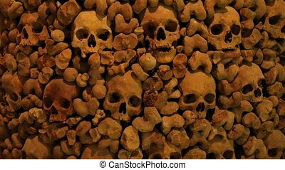 Skulls and bones in a wall - Wall made of human bones