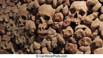 Skulls and bones in a wall - Wall made of skulls and human ...