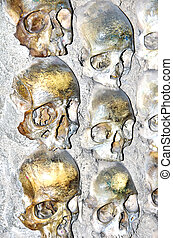 skulls on wall in the bones chapel of Evora.