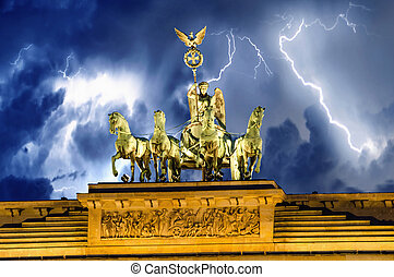 Frontal view of Quadriga Monument Over Brandenbourg Gate in Berlin (Germany), in horizontal composition.
