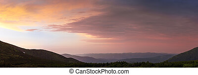 Sky after sunset over the Carpathian Mountains, panoramic view