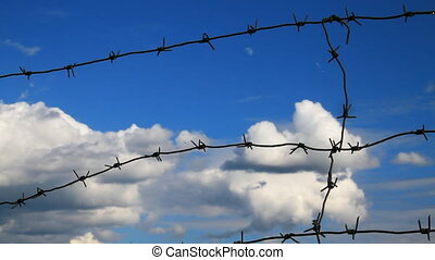 Sky and Barbed Wire - Barbed wire on the blue sky...