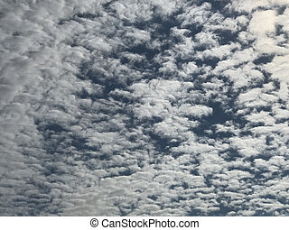 Sky background crowded with patches of clouds.Photo Image -...