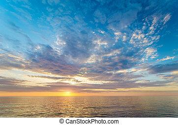 Sky background on sea shore sunset.