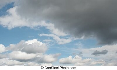Sky becomes lighter. Clouds are flying quickly on the blue...