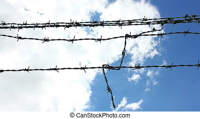 Sky Behind Barbed Wire