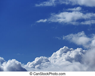 Sky blue with the white fluffy clouds below