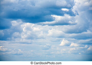 Sky clouds on a background of bright blue sky
