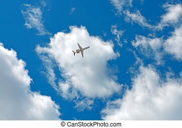 sky, clouds, plane - plane flying among white clouds and the...