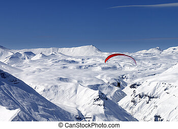 Sky gliding in snowy mountains