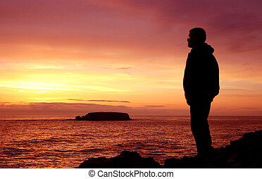 Man looking out over ocean