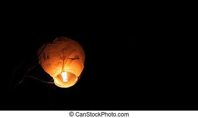 Sky lanterns - Festival launch air lanterns into the sky.