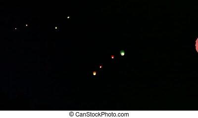 Sky lanterns. Night