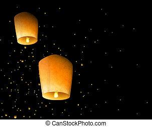 Sky lanterns - Two sky lantern in the night sky. Eps 10