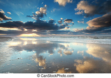sky reflection in North sea water