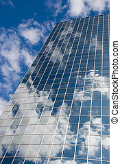 Sky reflection in the modern office glass building.
