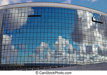 Sky reflection in windows of modern building. Background.
