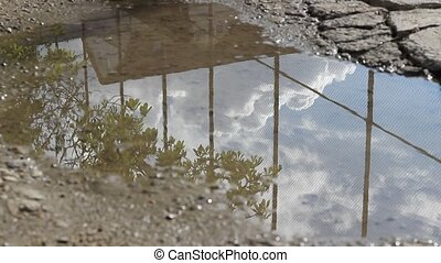 Sky Reflection on Puddle