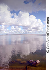 Sky reflections on lake water.