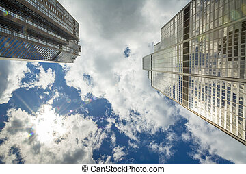 Sky Scrapers reach to the sky with sun flair - Sun flair and...