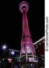 AUCKLAND, NZ - OCT 08:Sky Tower lit in red at night on Oct 08 2013.At 328 metres, the Sky Tower is the tallest man-made structure in New Zealand
