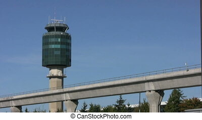 Sky Train And Airport Tower - A futuristic shot of a sleek...